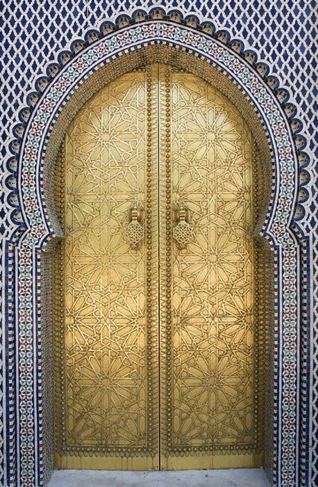Intricate Moroccan architecture. A royal door entrance in Fes.