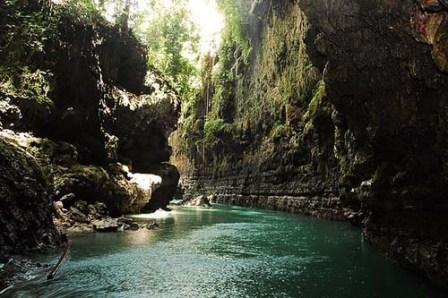 Green Canyon, West Java | A serene prehistoric experience with splashes of cool river water.