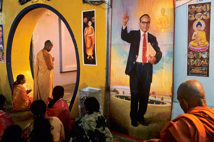 Dalit Buddhist worship in front of a banner of Dr. B.R. Ambedkar a main architect of the Indian Constitution promoter of Buddhism amongst the Dalits./ Photography by Steve McCurry / Here you can download Steve's FREE PDF Catalog and order PRINTS /stevemccurry.com/...