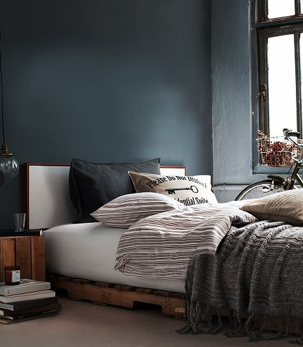 Pallets used as box spring. Nice modern theme bedroom.