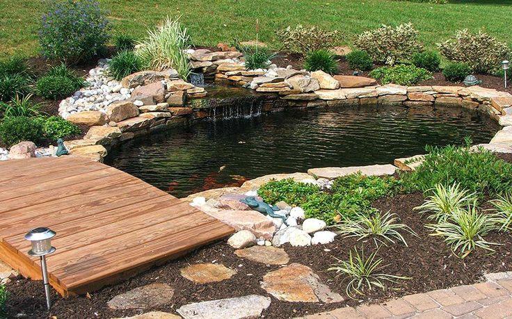 Love the bridge, waterfall, and rocks used   Garden pond ...