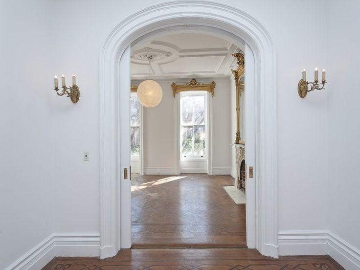 A look at the arches and beautiful sconces. Source: Sotheby's Realty