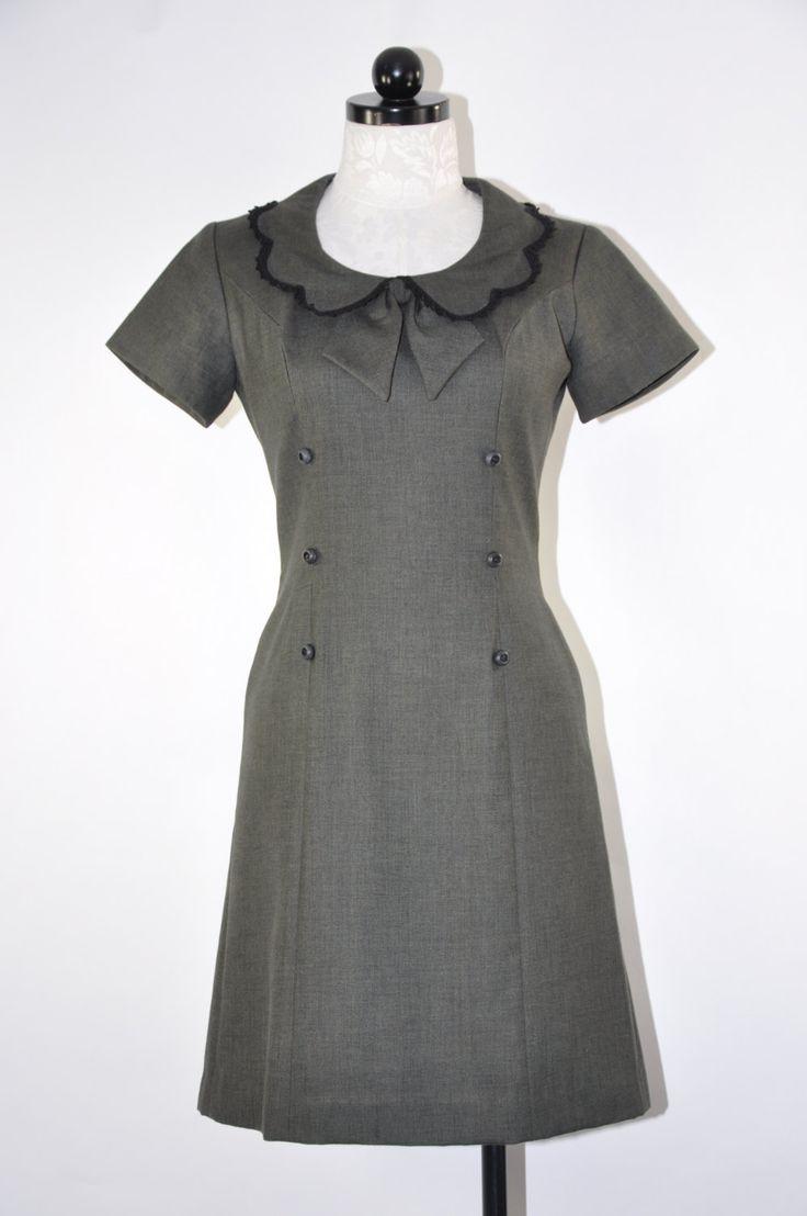 Vintage 1960s donkere Legergroene uitgerust jurk met prachtige geschulpte peter pan kraag met zwarte haak trim, pijl en boog korte mouwen prinses