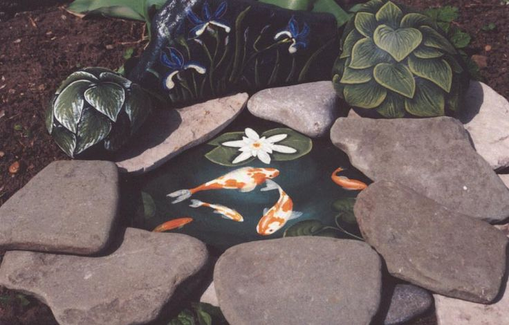 And this is something that I plan to do in my garden! The Koi are painted on slate that was painted with black cement paint. Notice the Hosta's painted on the rocks behind the fake pond!