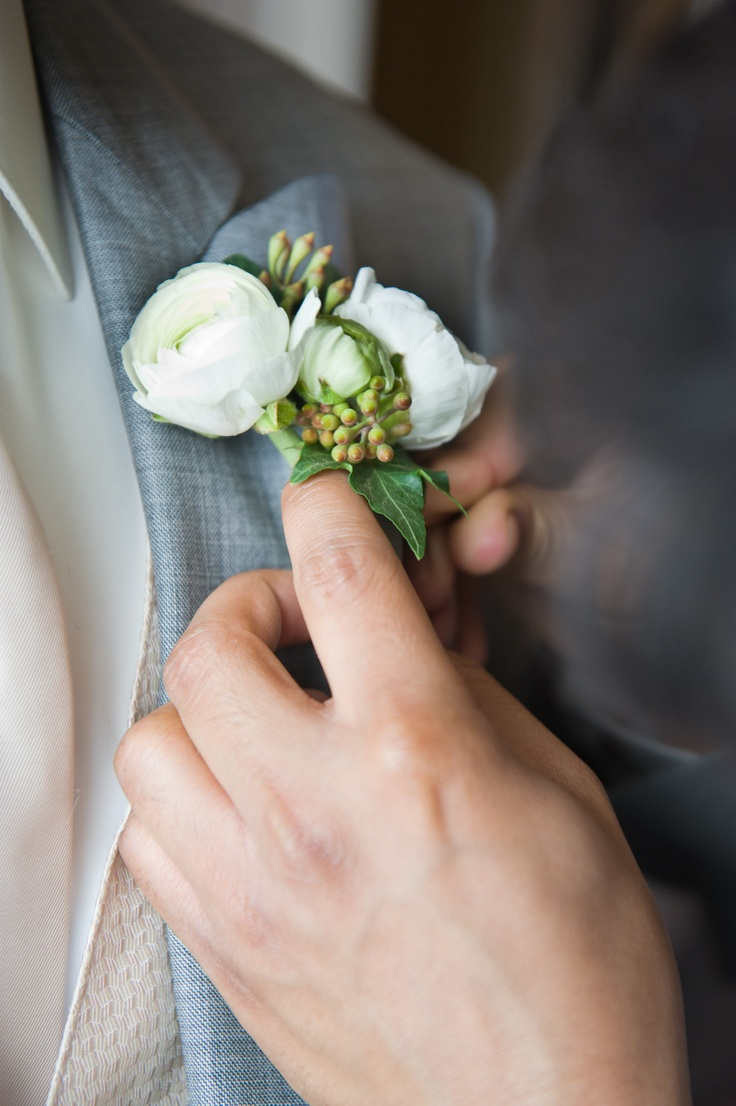 Simple, clean boutineer with white Spray Roses and Eucalyptus by Eden Floral Boutique.