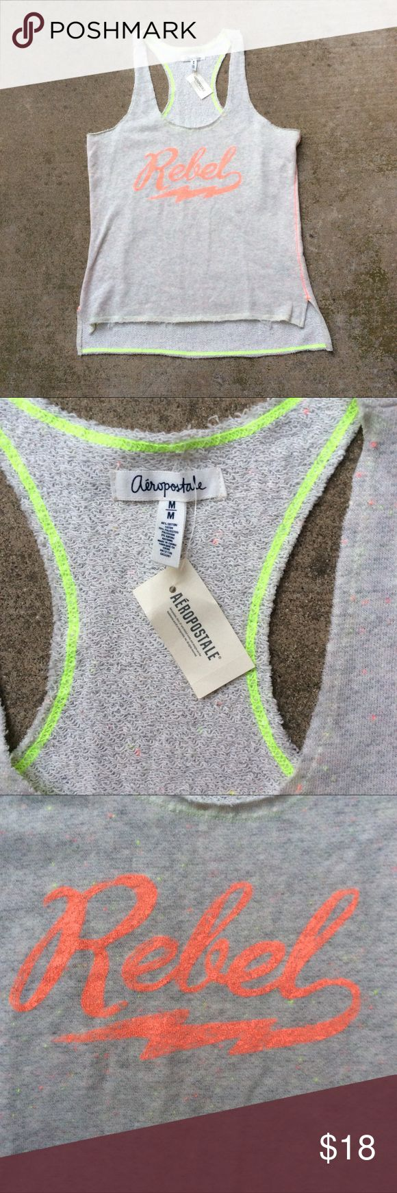"Women's Aeropostale nwt rebel tank OVERVIEW  STYLE NUMBER: 9049  French terry material  Script graphic  Racerback style tank  Hi lo hemline  Size medium   Approx measurements laying flat:  Pit to pit 18.5""   New with tags Aeropostale Tops Tank Tops"