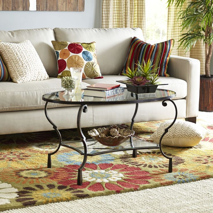 http://www.pier1.com/chasca-glass-top-brown-oval-coffee-table/2424956.html?cgid=coffee-tables $260 Cdn (sale)