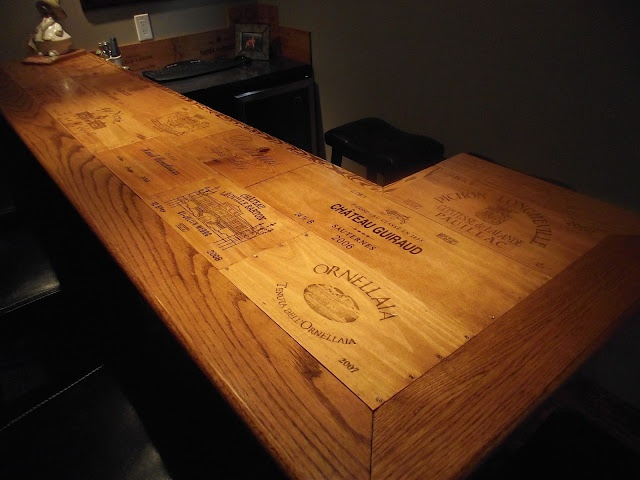 This is a custom wine bar with a tabletop crafted with for Custom wine bar