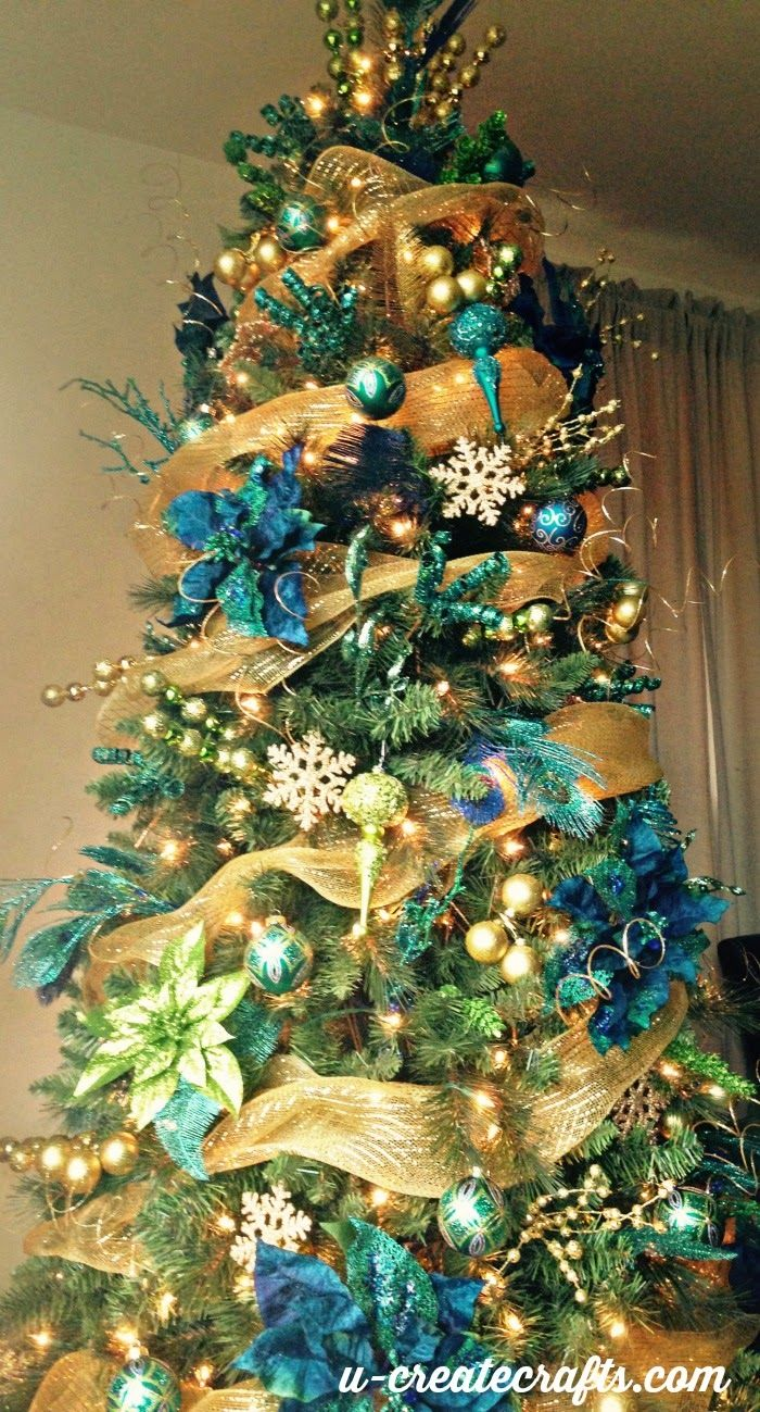 Best 25 peacock christmas decorations ideas on pinterest for Blue gold and white christmas tree