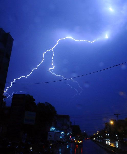 A lightning is pictured over Lahore City during a thunder storm that was followed with heavy rain on April 13, 2012.