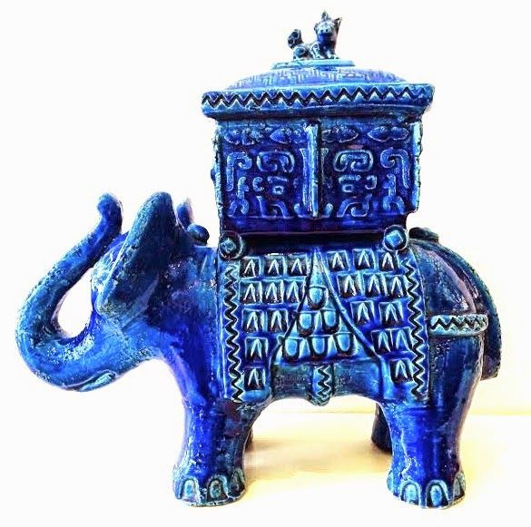 Aldo Londi meets Marco Polo. Another great example of a cross-cultural curiosity, this fantastic and large Indian elephant is carrying what appears to be a Ming dynasty Chinese bronze lidded jar. Attributed to Aldo Londi for Bitossi from the 1960s. 14 inches tall and 15 inches wide.