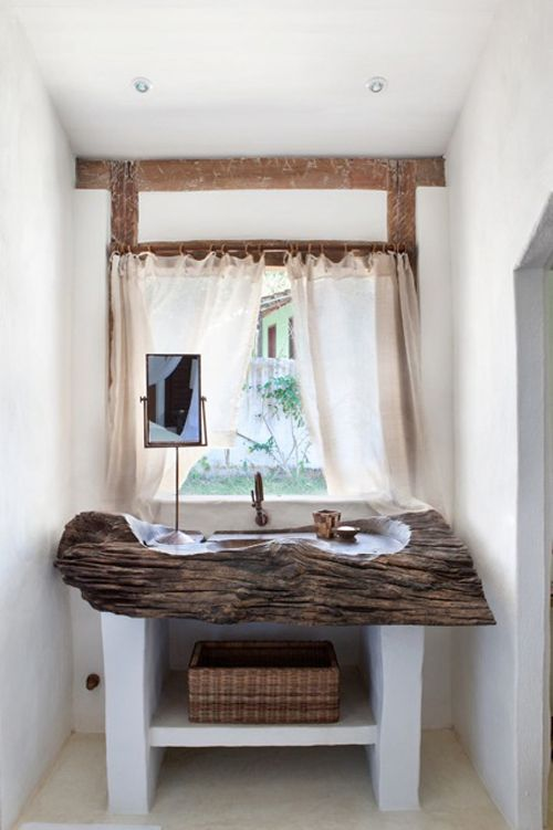 Line the carvings with copper or zinc and seal the wood with marine varnish & this would be a beautiful outdoor bathroom trough.