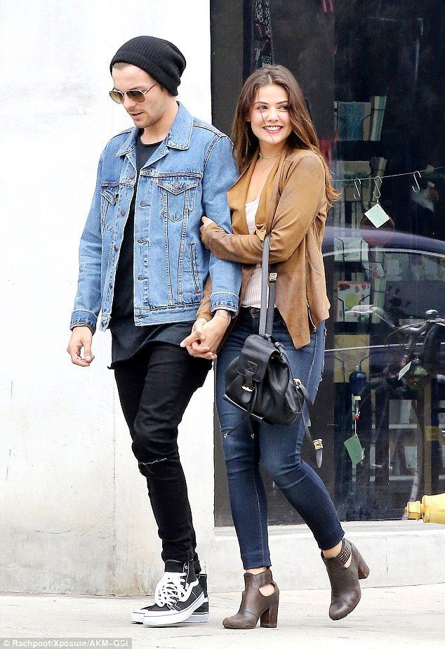 Trademark style: Louis kept his style understated in black jeans and a coordinating T-shir...