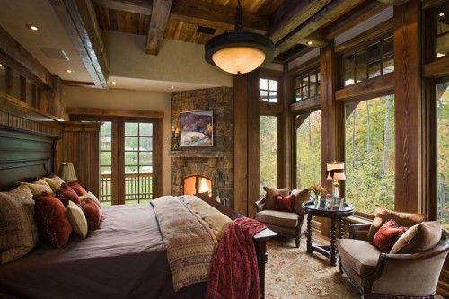 I would never want to get out of bed...LOL! what an awesome room to wake up in....all those windows.