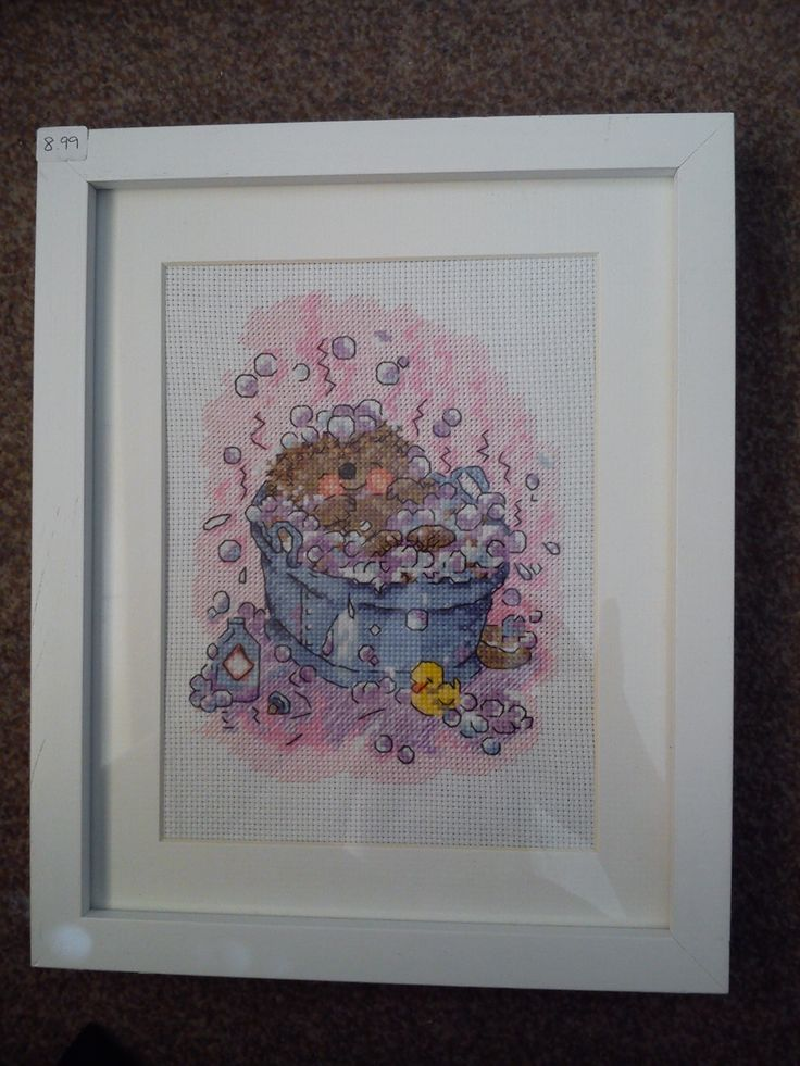 hedgehog in a bubble bath cross stitched and framed by Tulipacious Designs.