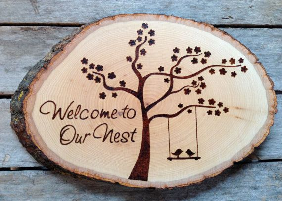 Welcome to our Nest Wood burned sign with blossom by bluemarket