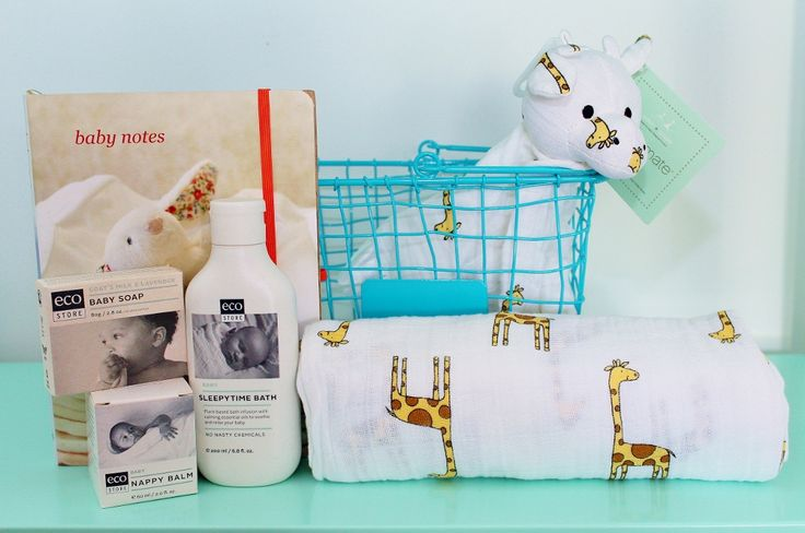 Newborn Baby Hamper in a General Eclectic Wire Basket. http://www.giftloft.co.nz/collections/kids-tots-gifts