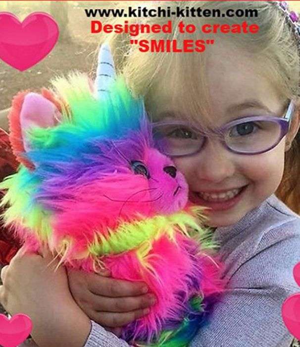 She is  very happy getting her new rainbow unicorn kitten. 30cm Tall & 8 different wing colors available. website direct, safe payments & delivery worldwide
