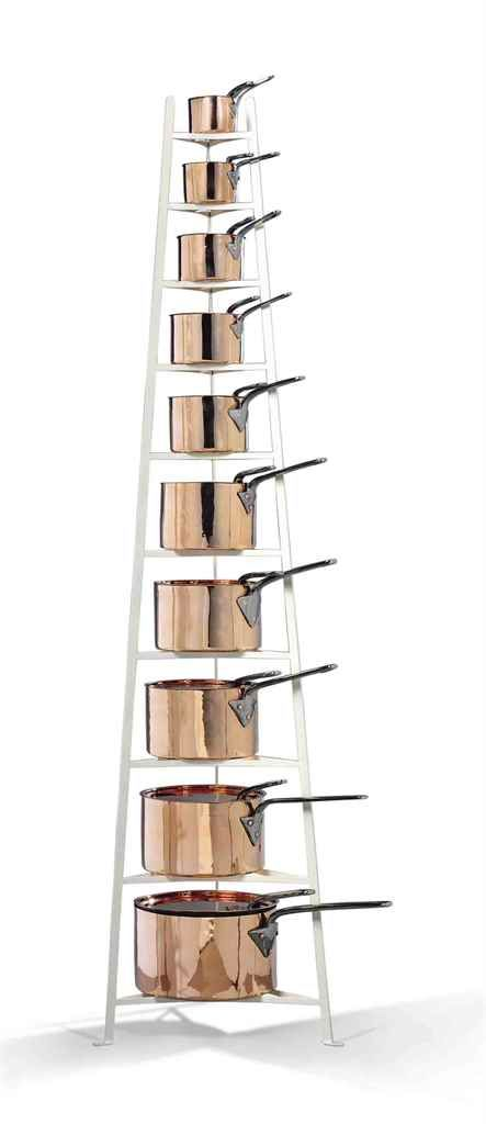 A GROUP OF TEN VICTORIAN GRADUATING COPPER SAUCEPANS AND COVERS LATE 19TH CENTURY On modern painted wrought-iron stand 80 in. (203 cm.) high, overall
