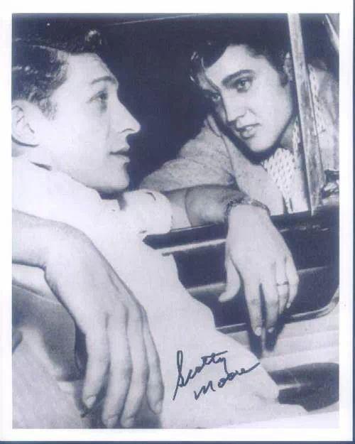 Elvis Presley with his guitarist, Scotty Moore.