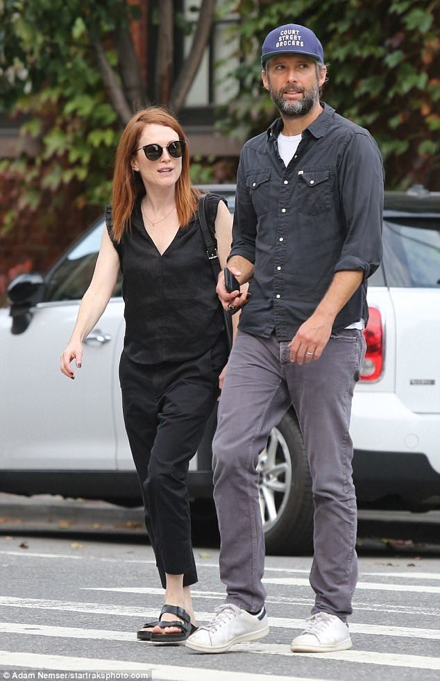 Back home: Julianne Moore stepped out with husband Bart Freundlich in New York on Wednesda...