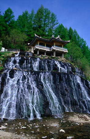 The waterfalls of Rimyongsu. The water comes straight through the mountain (not over the cliffs) and passes beneath the viewing pagoda into the river below.~ N. Korea