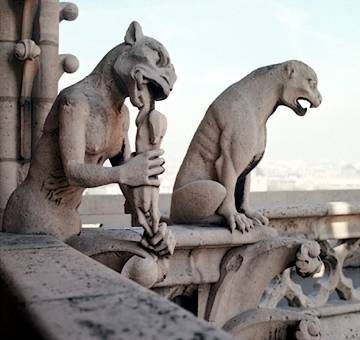 The gnawing gargoyle on Notre Dame cathederal: I have a repro of this one; I love the thoughtful look on his face.  While mine isn't a true gargoyle - he's not attached to a building - I like to think that transcendentally he's doing his job of keeping the rain away :)