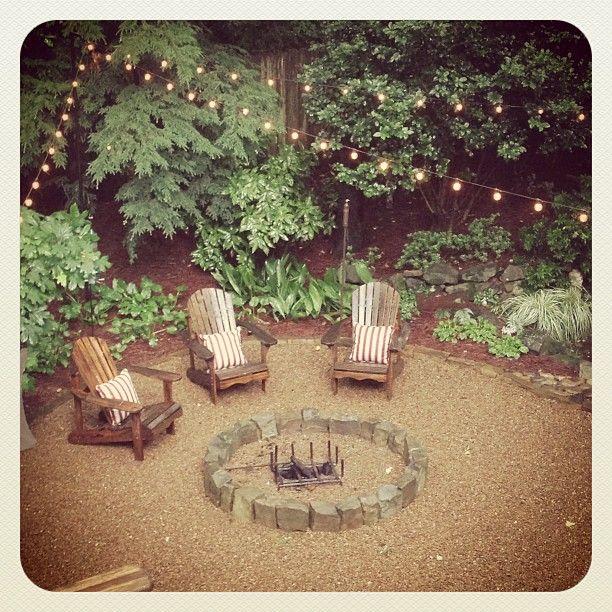 Sherry Hart backyard. pea gravel and adirondaks