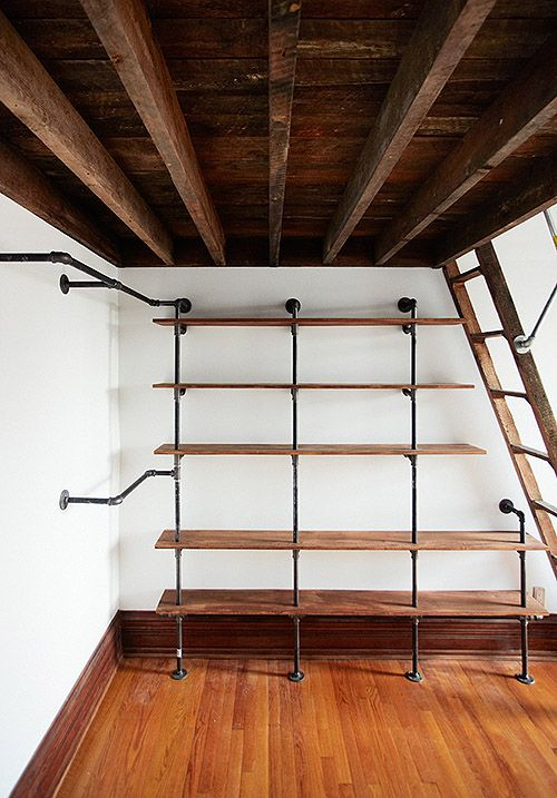 This is a neat combination of shelving and hanging space for clothes. Could be used in a closet or an open loft space like this.