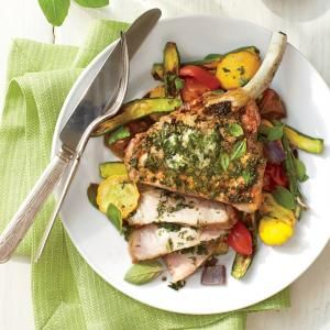 Broiled Pork Chops with Basil Butter and Summer Squash | The basil butter is the star here: It seasons the pork and adds an herby, rich flavor to the roasted squash.