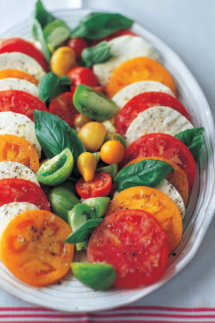 A simple tomato and mozzarella salad with fresh basil when heirloom tomatoes are in season is always a good idea.