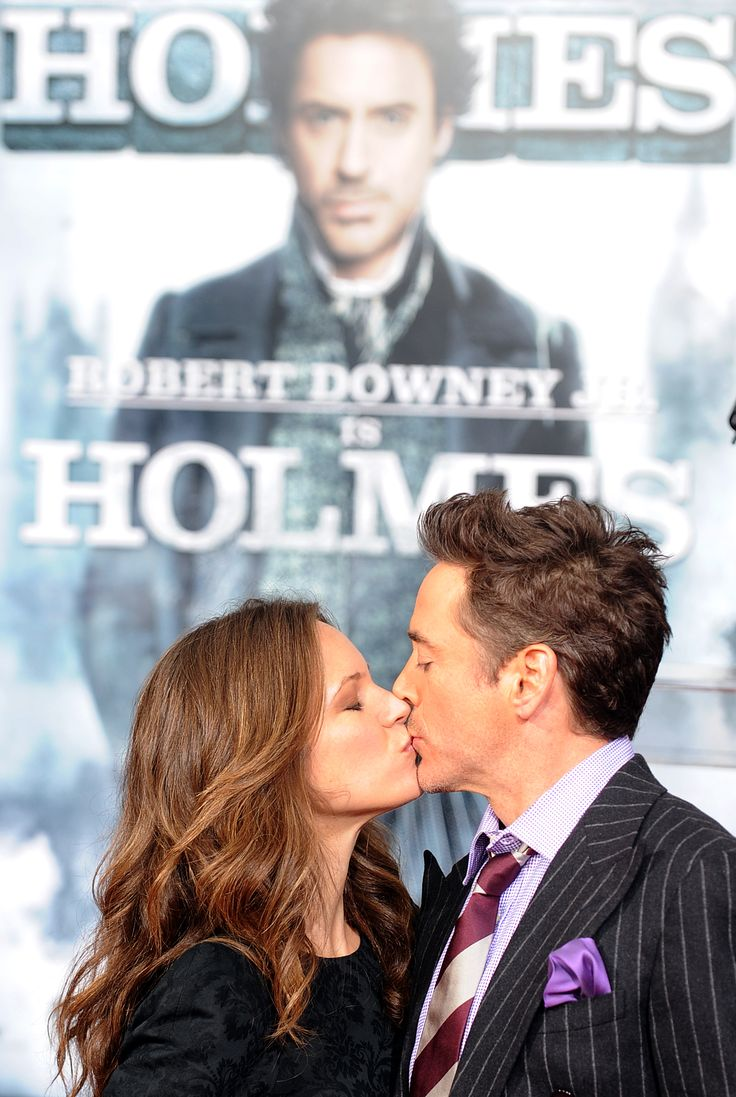 "Robert Downey Jr. and Susan Downey kiss during red-carpet festivities at the premiere of ""Sherlock Holmes"" (2009)."