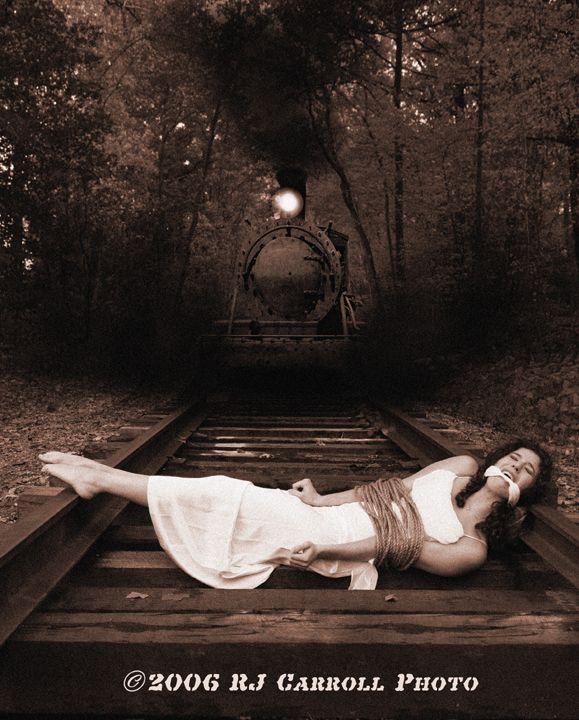 Charming Girl tied to tracks