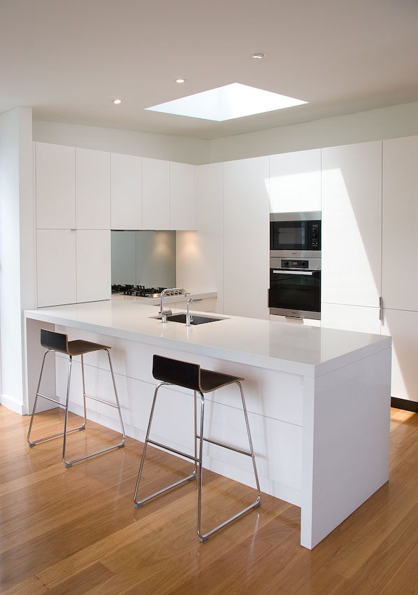 A classic white custom designed kitchen with Miele appliances