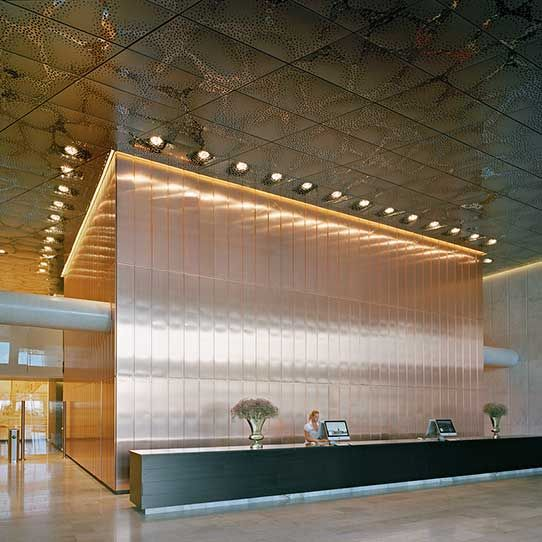 stockholm waterfront office block reception hall stainless steel ceiling and copper wall - Stainless Steel Hotel Design