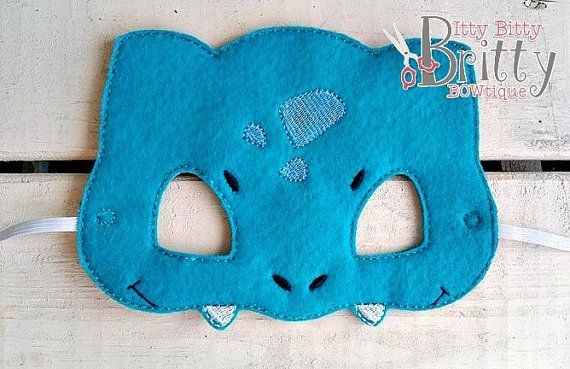 Pokemon, Bulbasaur inspired mask This is a finished embroidered item. All of our items leave our hands and are collected by USPS within 3-5 business days. Our standard shipping is First Class Mail. Please expect 2-9 days for delivery. Please send us a message if you would like to upgrade