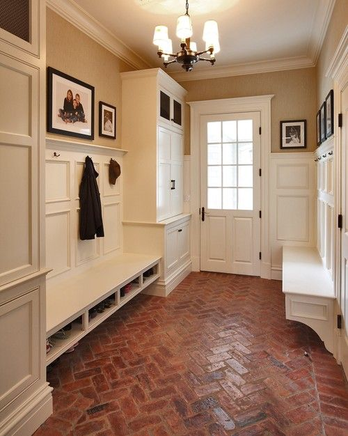 Tan walls, white trim and wainscoting, herringbone brick floors. Hunting Ridge Road mud room, NY. Country Club...