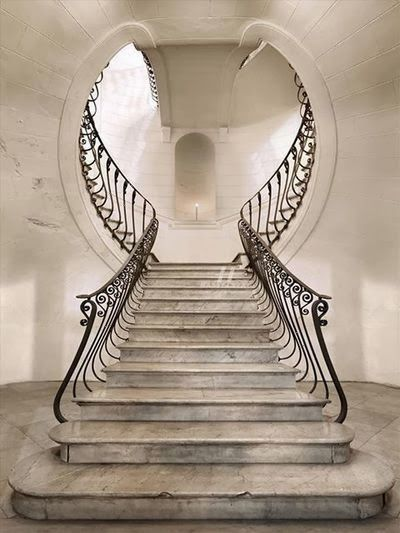 Art Deco Staircase, 1930s, featuring white accents. The stairways characteristics also includes smooth lines and organic shape.
