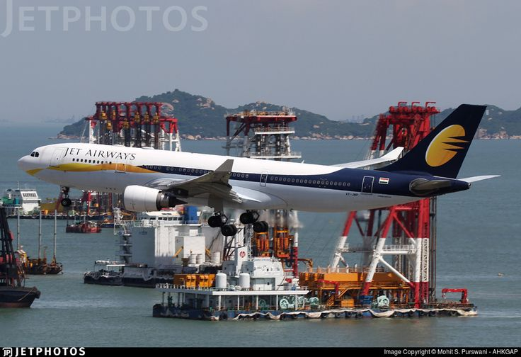 The construction of the third runway at Hong Kong's Chek Lap Kok Airport has resulted in a very nice background for arrival photos of 25R taken from the T2 observation deck.  This Jet Airways A332 is seen here moments from landing while land reclamation work carries on in the background.. VT-JWP. Airbus A330-202. JetPhotos.com is the biggest database of aviation photographs with over 3 million screened photos online!