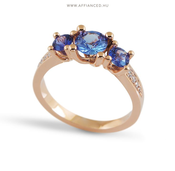 Handcrafted engagement ring with, brilliants and sapphires.