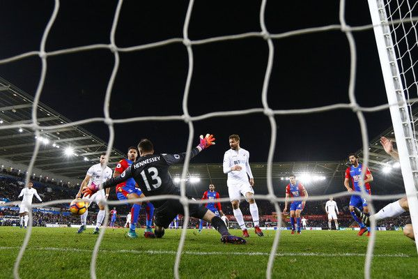 Fernando Llorente of Swansea City scores his team's fifth goal past Wayne Hennessey of Crystal Palace during the Premier League match between Swansea City and Crystal Palace at Liberty Stadium on November 26, 2016 in Swansea, Wales.