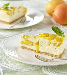 White Chocolate Mango Swirl Cheesecake - The taste of warmer months is in this cheesecake…corn syrup makes a great sticky mango sauce to swirl through this cheesecake. It's an easy Christmas recipe if you're busy.