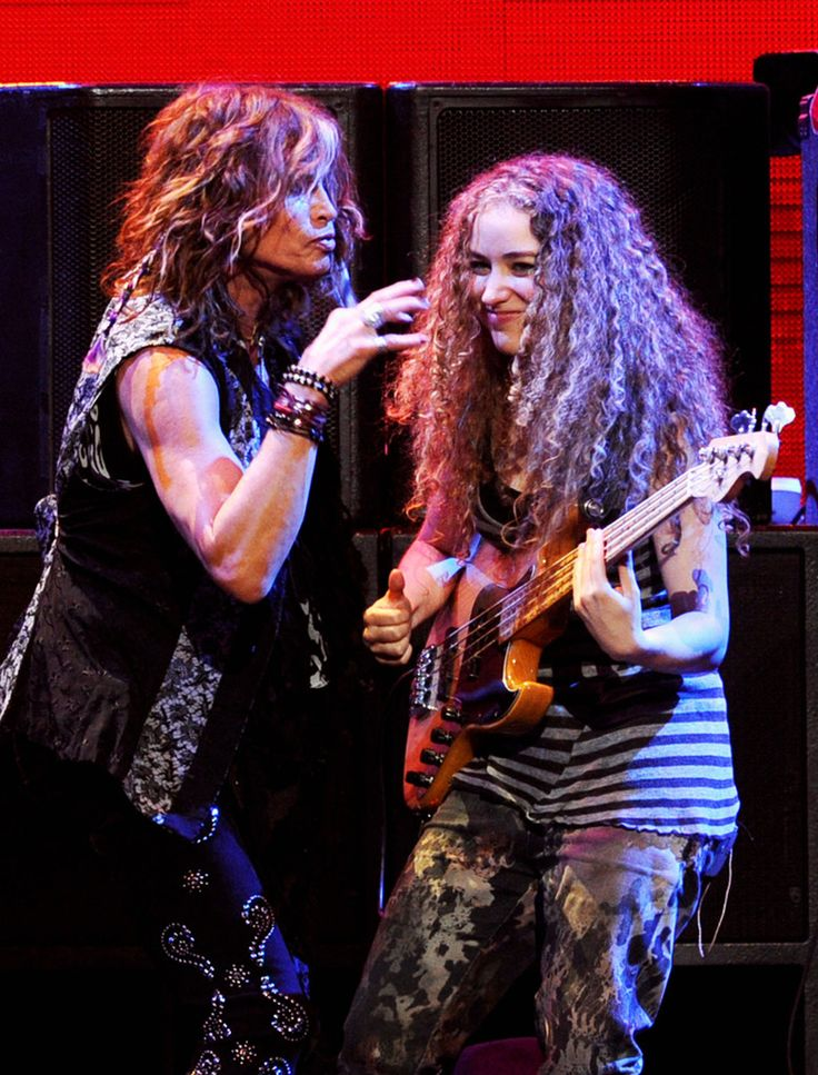 Steven Tyler - iHeartRadio Music Festival - Day 2 - Show  Singer Steven Tyler (L) and musician Tal Wilkenfeld perform onstage at the iHeartRadio Music Festival held at the MGM Grand Garden Arena on September 24, 2011 in Las Vegas, Nevada.
