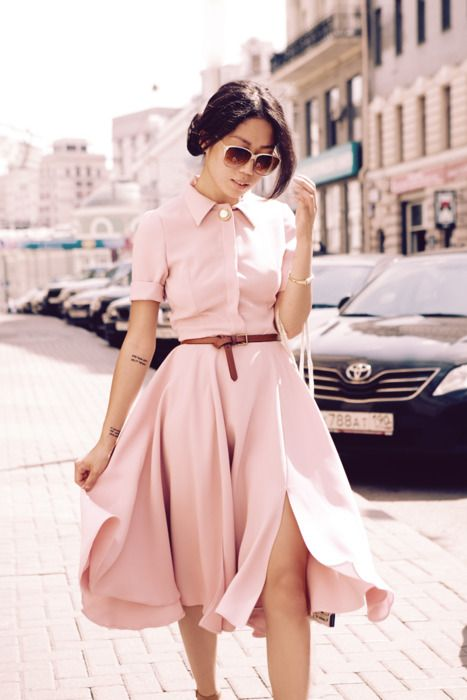 pink dress with short sleeves and colar detail. Love this 50's styling.