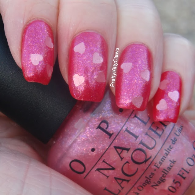 OPI Nothin' Mousie 'bout It, swatched on nail wheel, clear base with tiny pink glitter and large glitter hearts, $7.50
