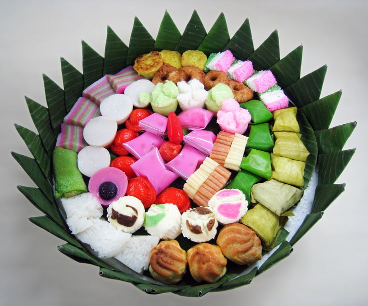 "Jajan Pasar (Indonesian for ""market munchies""), assorted colorful Indonesian traditional cakes (kue) served during festivities. The delicacies are kue dadar gulung, kue lapis, bika ambon, kue talam, nagasari, kue mangkok, kue ku, kue bugis, kue cucur, getuk lindri, bolu kukus, putu mayang, kue sus, etc. This version was edited to remove distracting detail from the background."