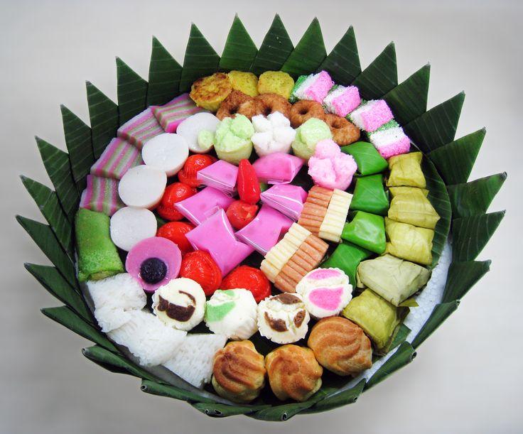 "Jajan Pasar (Indonesian for ""market munchies""), assorted colorful Indonesian traditional cakes (kue) served during festivities. The delicacies are kue dadar gulung, kue lapis, bika ambon, kue talam, nagasari, kue mangkok, kue ku, kue bugis, kue cucur, getuk lindri, bolu kukus, putu mayang, kue sus, etc. This version was edited to remove distracting detail from the background."