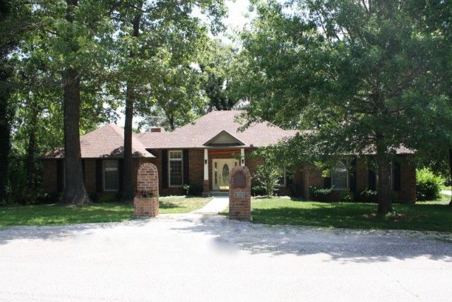 Completely Custom Contemporary Brick Home in Quail Run Subdivision, Surrounded by other beautiful homes,on an extra large corner lot! 4 Bedroom 3 Bath with 2 car attached garage and John Deere garage below in the full walkout basement! Beautiful covered Patios, Open Floor plan with Large Master Suite. 10 foot Ceilings and gorgeous tall windows, hardwood floors,huge sunroom with tile floors,cedar lined closets,sprinkler system,gas log fireplace,water softener, sprinkler system, large concrete…