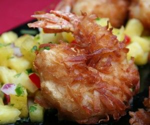 Even if a weekend getaway to the tropics isn't on your agenda, these Crispy Coconut Shrimp with Pineapple Relish appetizers will surely get in you in a tropical state of mind.