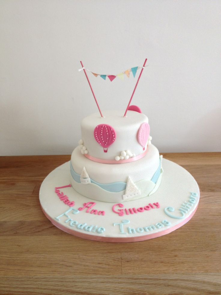 Joint christening cake boats hot air balloons 2 tiered boy and girl cake by candyscupcakes.co.uk